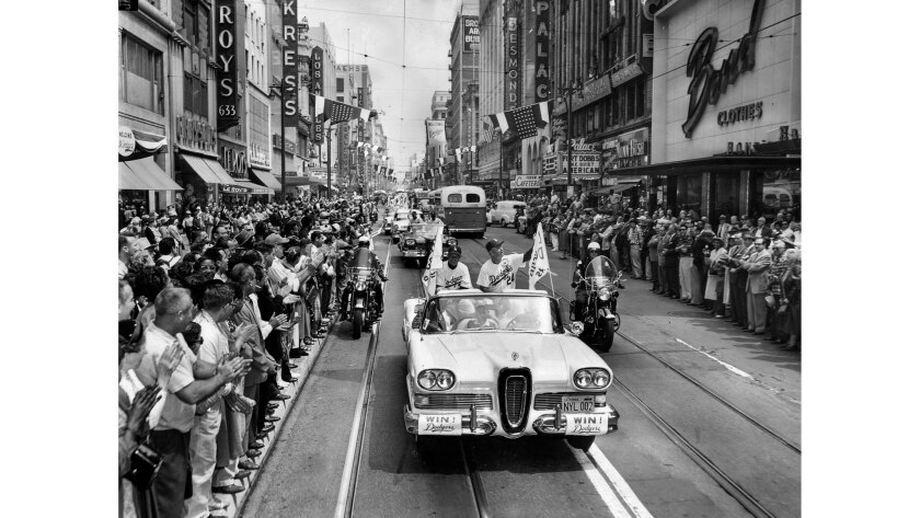 April 18, 1958: Spectators line Broadway as Dodgers manager Walter Alston, right, and coach Charlie