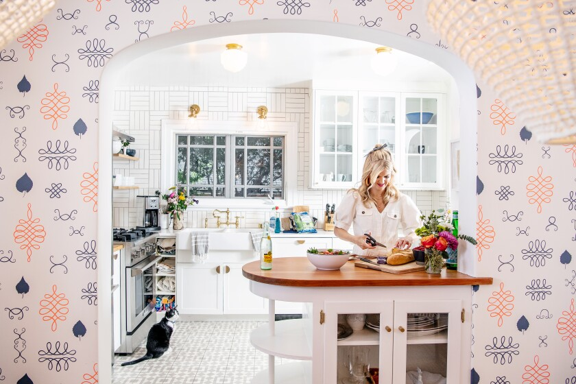 Arden Myrin's kitchen is complemented by hand-printed wallpaper by Juju Papers.