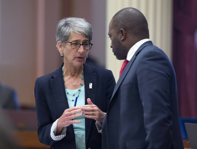 State Sen. Hannah-Beth Jackson, D-Santa Barbara, talks with Assemblyman Tony Thurmond, D-Richmond, at the Capitol Wednesday, Aug. 31, 2016, in Sacramento, Calif. The state Senate approved Jackson's bill, SB654, which would give those employed by businesses with 20 to 49 employees to receive six wee