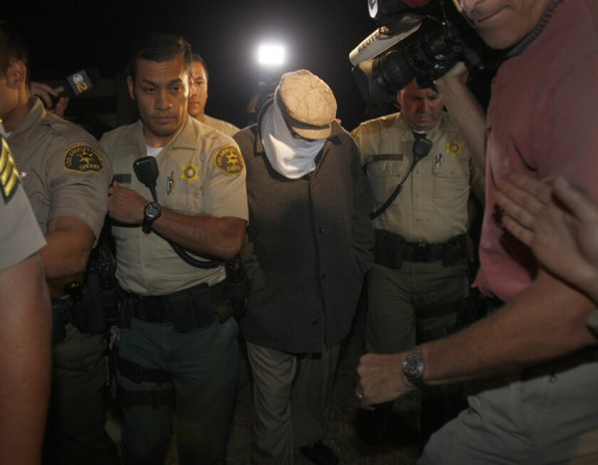 "Los Angeles County sheriff's deputies take Nakoula Basseley Nakoula, the filmmaker behind ""Innocence of Muslims,"" into custody in 2012 for a probation violation not related to the movie."