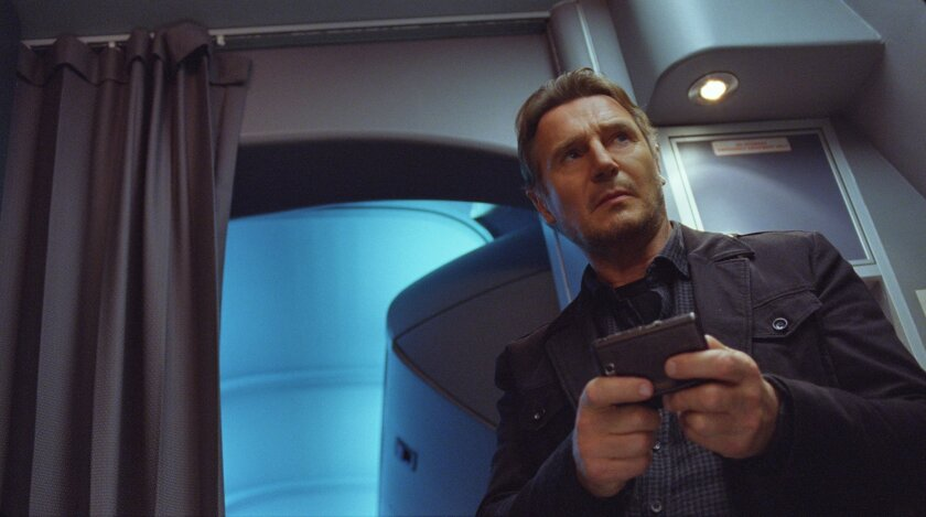 """This image released by Universal Pictures shows Liam Neeson in a scene from """"Non-Stop."""" (AP Photo/Universal Pictures)"""