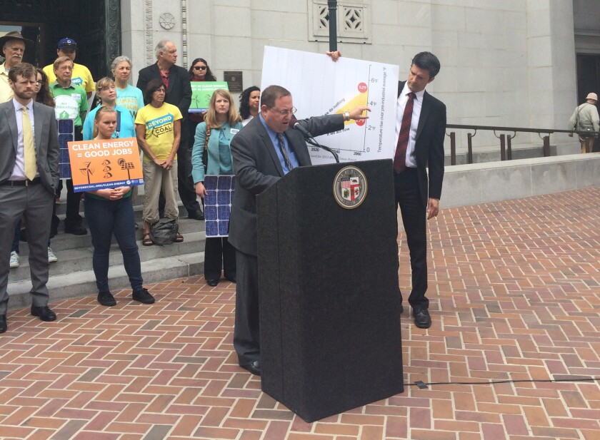 Los Angeles City Councilman Paul Koretz announces his proposed new goals for reducing citywide greenhouse gas emissions at City Hall on Friday.