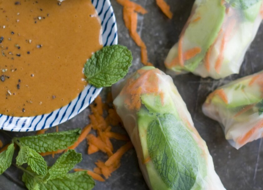 This Dec. 2, 2013 photo shows chicken and jicama spring rolls with peanut sauce in Concord, N.H. (AP Photo/Matthew Mead)