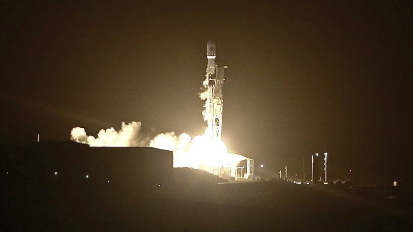 In this Sunday, Oct. 7, 2018 photo, a SpaceX Falcon 9 rocket blasts off from Vandenberg Air Force Ba