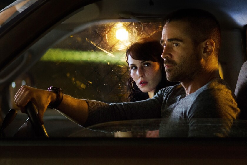 """Noomi Rapace, left, and Colin Farrell in a scene from """"Dead Man Down."""""""