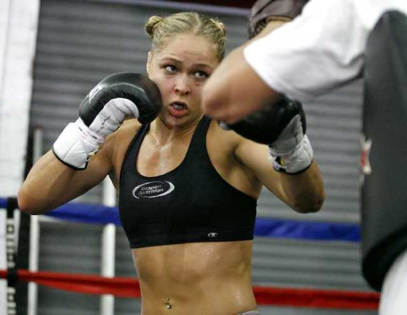 """Ronda Rousey trains at Glendale Fighting Club for her first Strikeforce women's bantamweight title defense with Sarah Kaufman on Aug. 18 at the Valley View Casino in San Diego in the main event of Strikeforce's """"Rousey vs. Kaufman"""" card live on Showtime."""