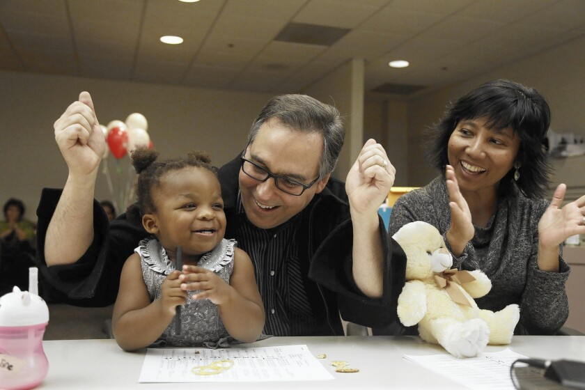 Darrin and Vicky Geary celebrate their adoption of Hannah May, 23 months.