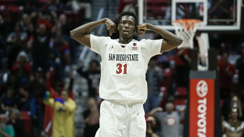 SDSU guard Nathan Mensah (31) cheers after a three pointer by Jordan Schakel (20) in the second half against New Mexico.