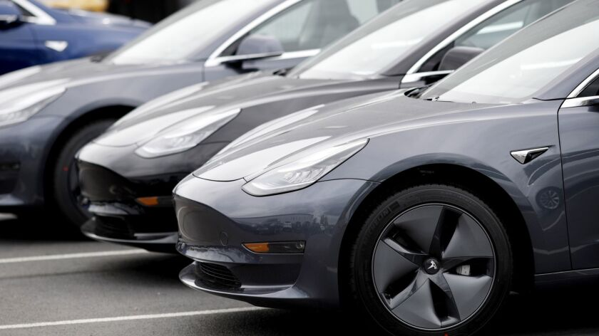 Unsold 2019 Model 3 sedans are lined up at a Tesla dealership in Littleton, Colo.