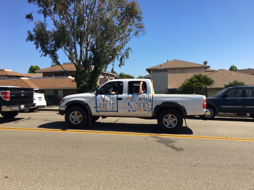 Vista parents and students objected to Vista Unified School District's grading system with a drive-up protest at the school headquarters and Rancho Buena Vista High on Tuesday.