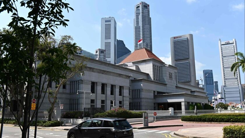 Singapore's Parliament, which has been dominated by the People's Action Party since the country gained independence from Britain more than 50 years ago, overwhelmingly supports a law combating false news.