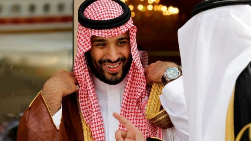 Mohammed bin Salman, left, smiles as he speaks with a fellow Saudi prince in Riyadh.