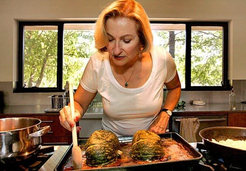 """At home in Ojai, """"Vegetarian Epicure"""" author Anna Thomas roasts kabocha squash for a soup in her new cookbook."""
