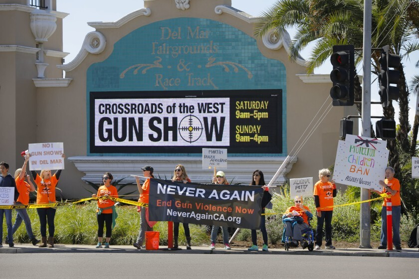 Supporters of NeverAgainCa protest outside the Del Mar Fairgrounds during a Crossroads of the West Gun Show in 2018.