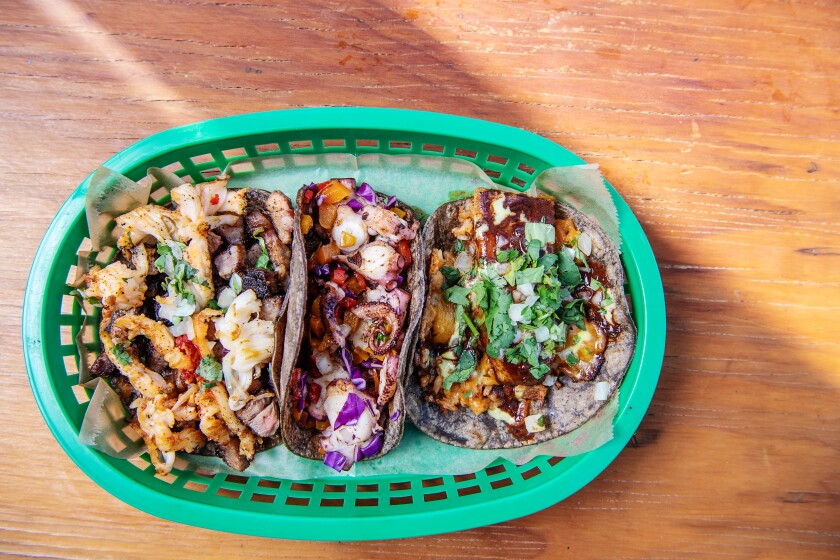 A spread of Máquina tacos including (from left), rib-eye and lobster, octopus, and mole pork belly.