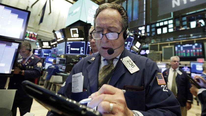 Trader Steven Kaplan works on the floor of the New York Stock Exchange.