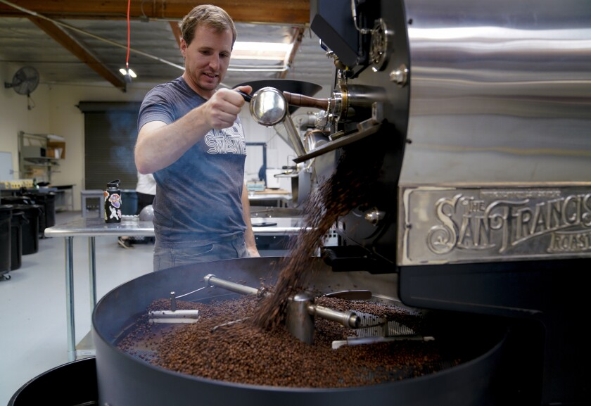 Elliot Reinecke releases the freshly roasted coffee beans that helped Steady State Roasting Co. win the 2020 Good Food Award this week. It's a big validation for company founder Elliot Reinecke of Carlsbad, who started roasting coffee as a hobby in a backyard shed a few years ago.