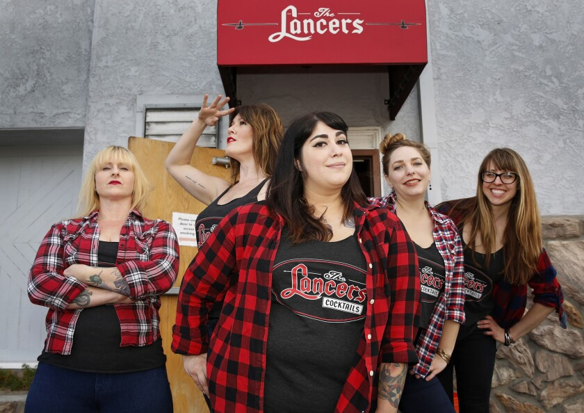 The ladies who tend bar at Lancers in University Heights include (from left) Lisa Johnson, Brittney Thompson, Chelsea Roop (center), Sarah Ford and Vita Naujokaitis.