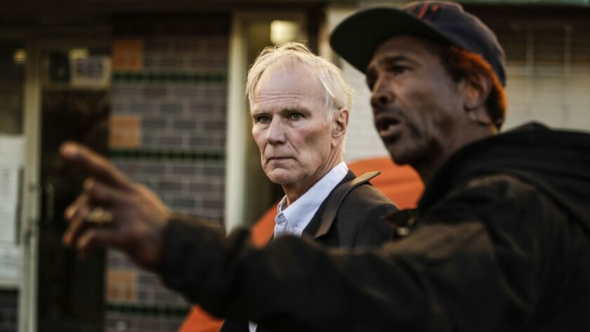 U.N. Rapporteur Philip Alston gets a tour of skid row with General Dogon on Dec. 5, 2017.