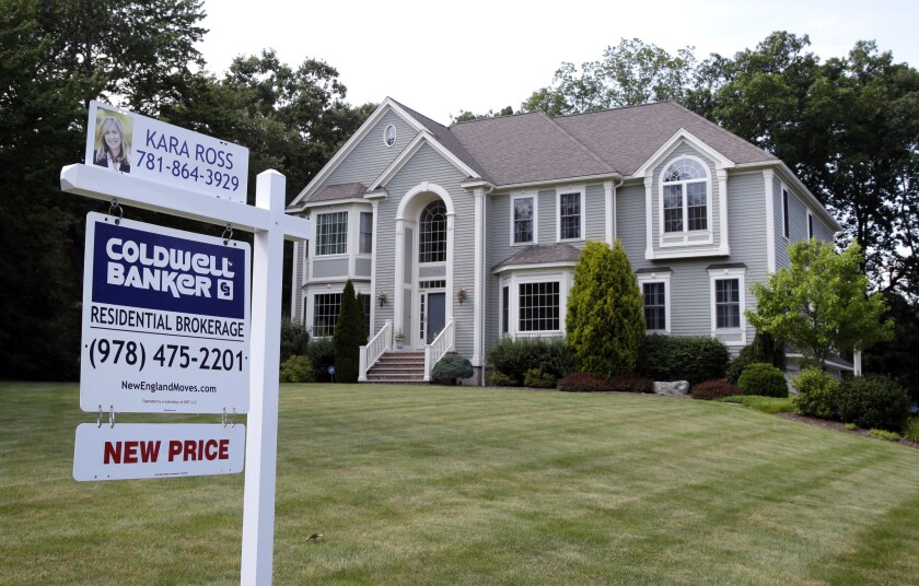 This Monday, July 10, 2017, file photo shows a house for sale, in North Andover, Mass.