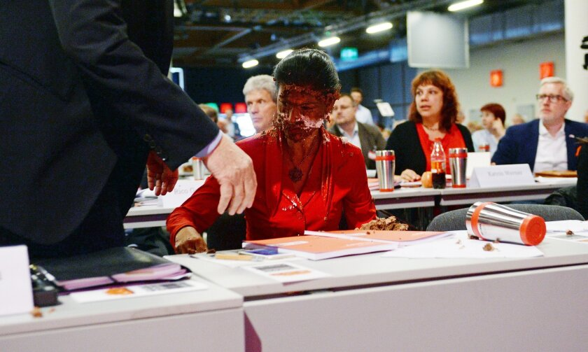 """Germany's main opposition leader Sahra Wgenknecht has her face covered with cream after activists threw a cake at her during a party congress in Magdeburg, Germany, Saturday, May 28, 2016. A group calling itself the """"Anti-Fascist Initiative 'Cake for Misanthropists'"""" distributed flyers pointing to"""