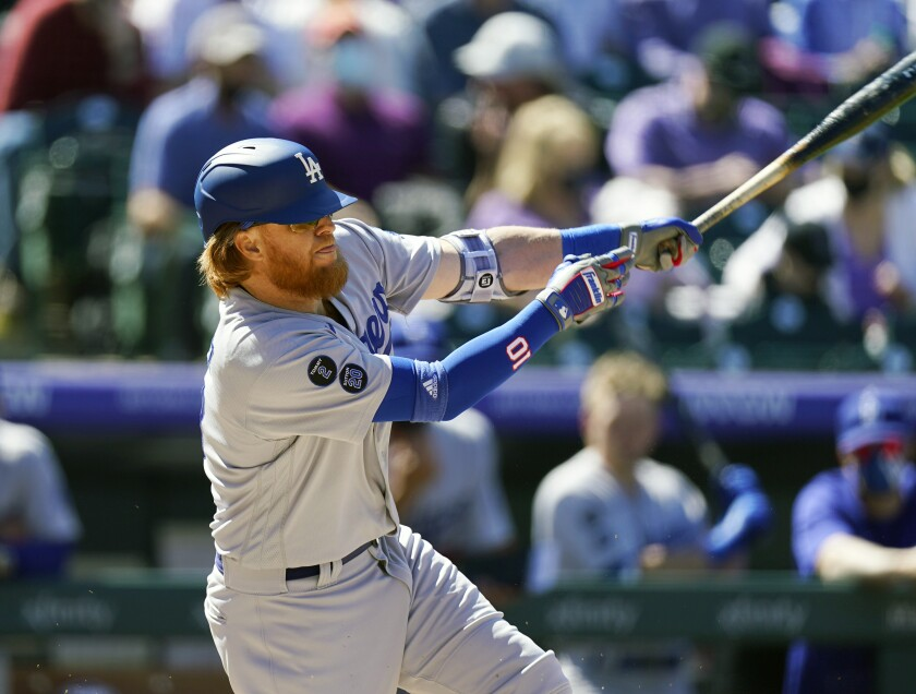 Los Angeles Dodgers' Justin Turner grounds into a double play against the Colorado Rockies in the first inning of a baseball game Thursday, April 1, 2021, in Denver. (AP Photo/David Zalubowski)