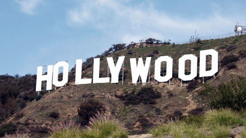 A photo from 2010 shows the Hollywood sign near the top of Beachwood Canyon adjacent to Griffith Par