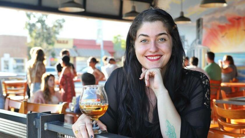 "Shelbi Bennett, lead singer of The Midnight Pine, relaxes at Rip Current Brewing in North Park. She said the band's new album has ""more of a punch,"" with a rhythm section. The album comes out Sept. 9. (For The San Diego Union-Tribune)"