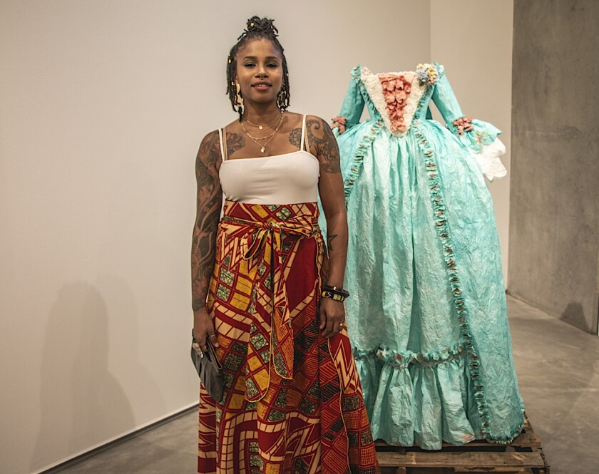 At the Sept. 6 opening of her Lux exhibition, Fabiola Jean-Louis posed with one of her paper gowns.