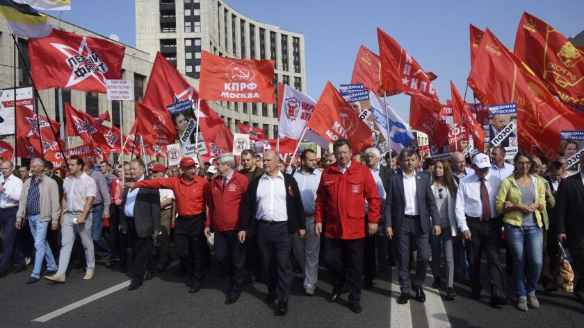 Communist Party leader Gennady Zyuganov, center, attends a rally organized by the Communist Party an