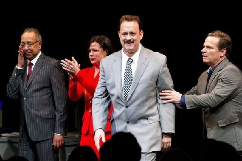 """This April 1, 2013 file photo shows, from left, George C. Wolfe, Maura Tierney, Tom Hanks and Peter Scolari at the Lucky Guy Opening Night, in New York. Hanks received a Tony nomination for best leading actor in a play, Tuesday, April 30, for his role in """"Lucky Guy."""" The awards will be broadcast on"""