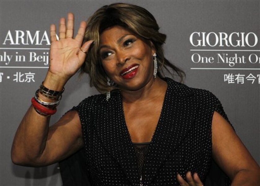 FILE - A Thursday, May 31, 2012 photo from files showing U.S. singer actress Tina Turner arriving for the Giorgio Armani fashion show held in Beijing. Legendary rock singer Tina Turner has married her longtime German beau, Erwin Bach, in a Swiss civil ceremony. The mayor of Kuesnacht, the wealthy Zurich-area community where Turner lives, says that she and Bach, a music executive, were married several weeks ago at the registry office. Markus Ernst told The Associated Press on Thursday, July 18, 2