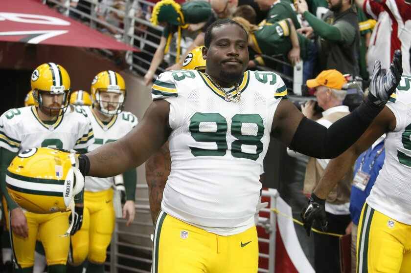FILE - In this Dec. 27, 2015, file photo, Green Bay Packers nose tackle Letroy Guion (98) gestures during an NFL football game against the Arizona Cardinals, in Glendale, Ariz. The Green Bay Packers have re-signed defensive tackle Letroy Guion, a move that could impact the return of fellow lineman