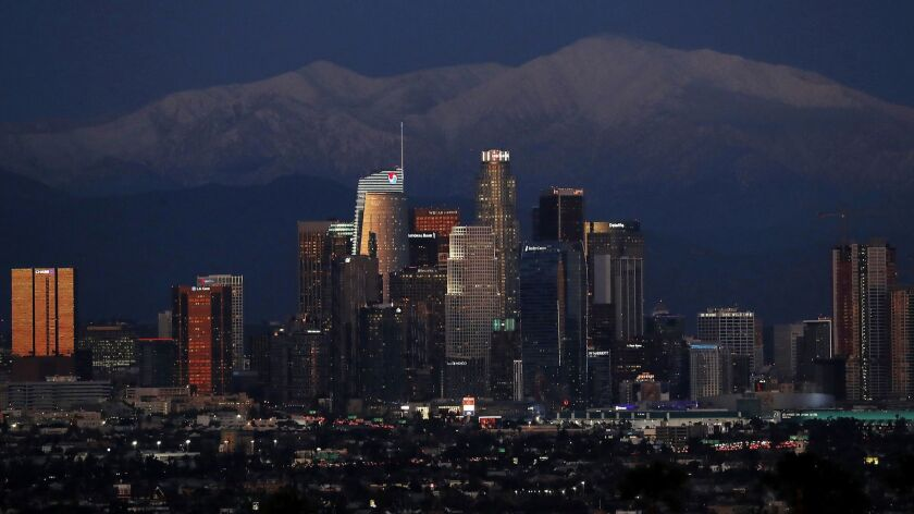 LOS ANGELES, CALIF. - FEB. 6, 2019. Snow covers the mountains behind the Los Angeles skyline on Wedn