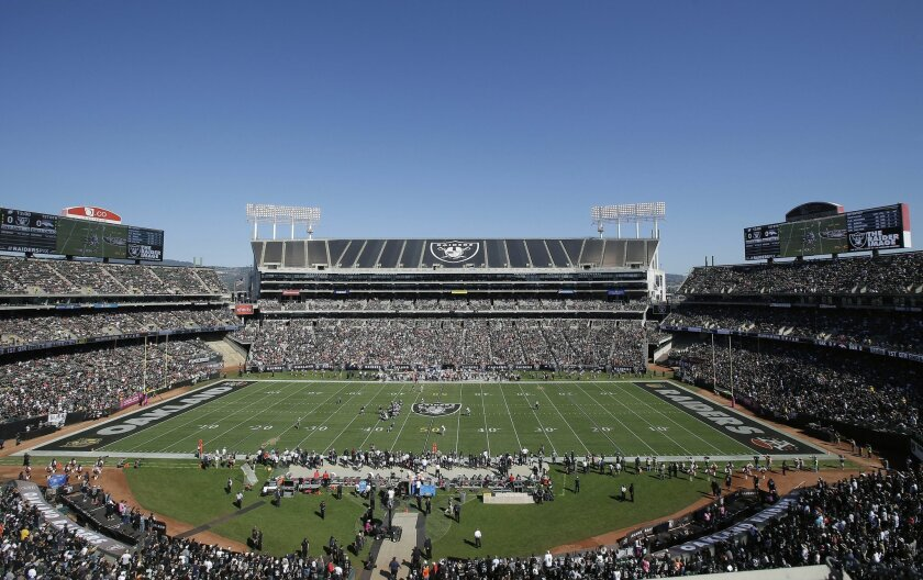 FILE - This Oct. 11, 2015, file photo shows an overall of O.co Coliseum during an NFL game between the Oakland Raiders and Denver Broncos, in Oakland, Calif. Oakland city officials are taking yet another run at financing a new stadium to keep the Oakland Raiders in town. Assistant City Administrato