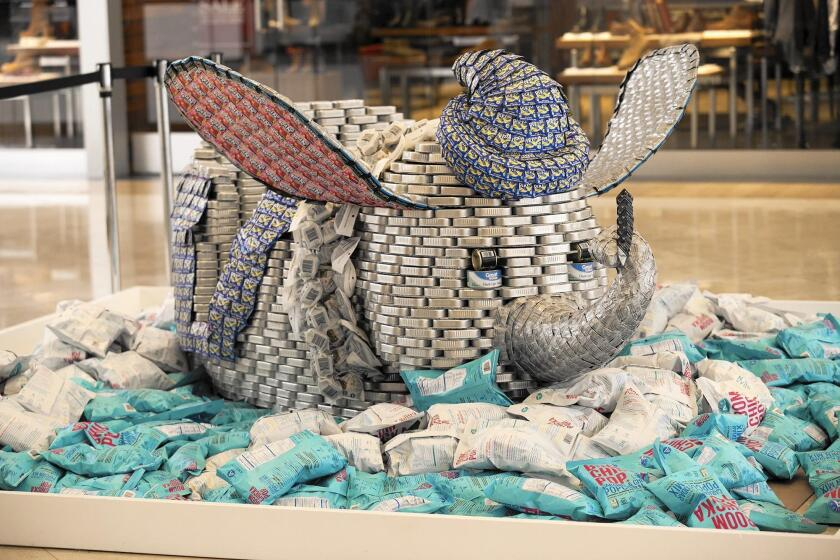 """Disneyland's """"If Elephants Can Fly, We Can End Hunger"""" sculpture, made of 4,200 cans, was part of last year's """"Canstruction"""" exhibit during the Festival of Children at South Coast Plaza in Costa Mesa. Thirteen such structures will be on display as part of this year's festival, which begins Friday."""