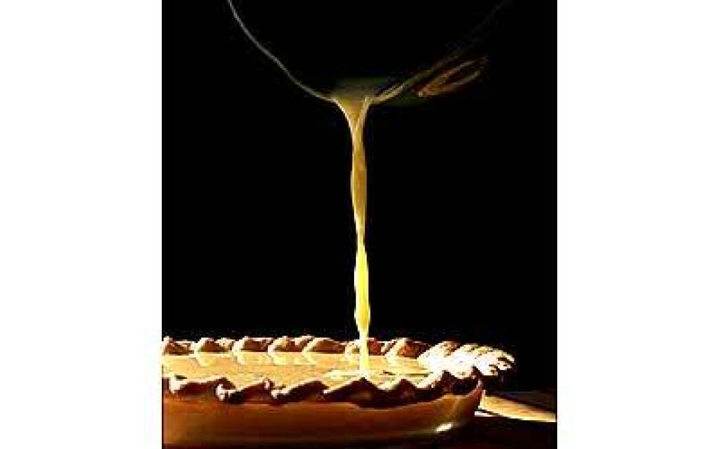 Custard is poured into a baked pie shell.