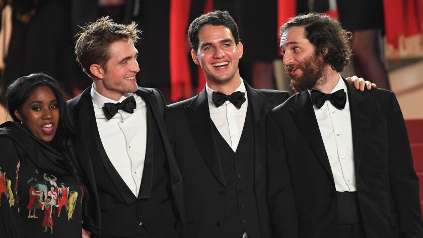 """Arriving at the Cannes premiere of """"Good Time,"""" from left, are actors Taliah Webster and Robert Pattinson, actor/co-director Benny Safdie and co-director Josh Safdie."""
