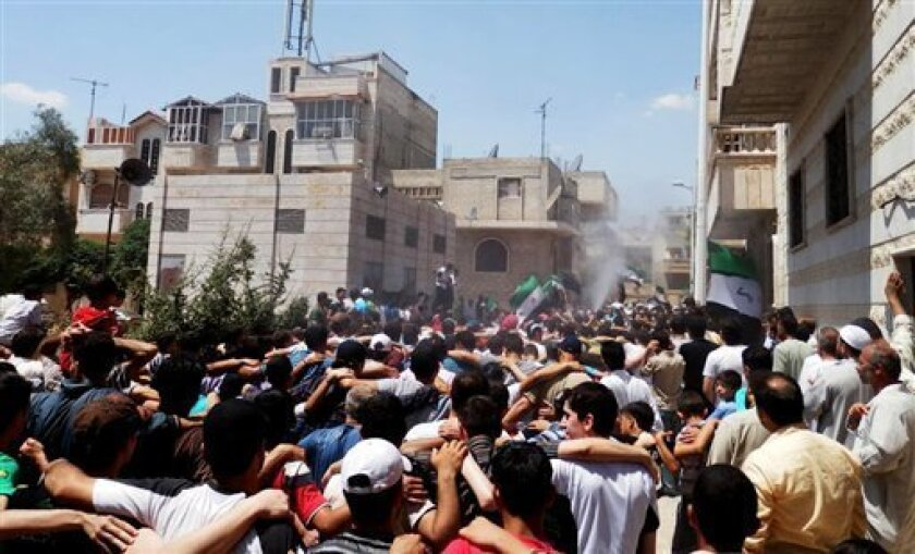 This citizen journalism image provided by Shaam News Network SNN, taken on Friday, July 6, 2012, purports to show Syrians chanting slogans during a demonstration in Hama, Syria. (AP Photo/Shaam News Network, SNN)THE ASSOCIATED PRESS IS UNABLE TO INDEPENDENTLY VERIFY THE AUTHENTICITY, CONTENT, LOCAT