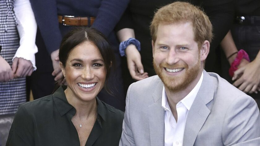 Meghan, the Duchess of Sussex and Prince Harry pose for a photo, during a visit to the Joff, Peaceha