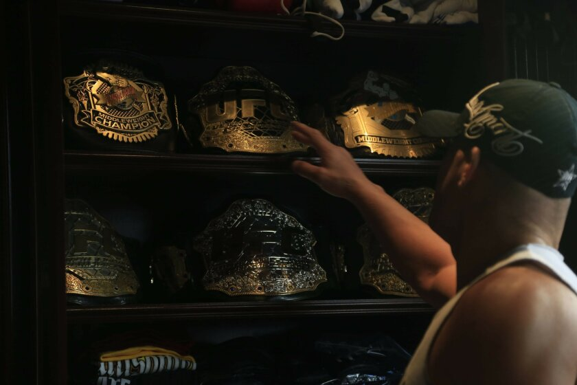 October 11th, 2014 Huntington Beach, CA- Mixed martial arts fighter Tito Ortiz keeps a cabinet holding his belts when he was the UFC middleweight champion. Photo by David Brooks/ U-T San Diego MANDATORY PHOTO CREDIT DAVID BROOKS / U-T SAN DIEGO; ZUMA Press.