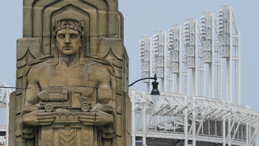 A guardian rests on the Hope Memorial Bridge within site of Progressive Field, Friday, July 23, 2021, in Cleveland. Cleveland's new name was inspired by two large landmark stone edifices near the downtown ballpark, referred to as traffic guardians, on the Hope Memorial Bridge over the Cuyahoga River. The team's colors will remain the same, and the new Guardians' new logos will incorporate some of the architectural features of the bridge. (AP Photo/Tony Dejak)