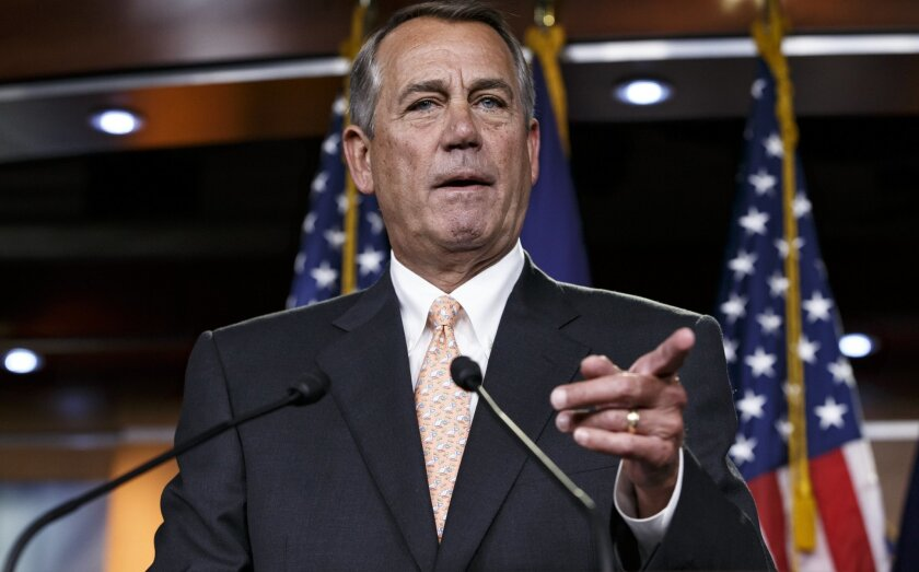 """House Speaker John Boehner of Ohio responds to reporters about the problems in passing the Homeland Security budget because of Republican efforts to block President Barack Obama's executive actions on immigration, Thursday, Feb. 26, 2015, during a news conference on Capitol Hill in Washington. The House voted last month to end Homeland Security funding on Saturday unless Obama reverses his order to protect millions of immigrants from possible deportation. After Democratic filibusters blocked the bill in the Senate, the chamber's Republican leaders agreed this week to offer a """"clean"""" funding measure, with no immigration strings attached. (AP Photo/J. Scott Applewhite)"""