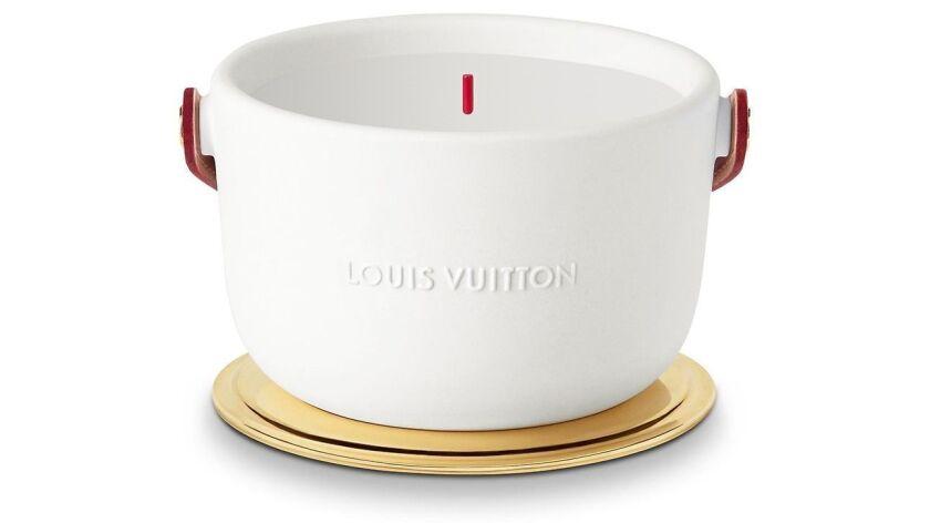 Louis Vuitton: Louis Vuitton?s L?air Du Jardin rose-scented fragrance candle is encased in white wi