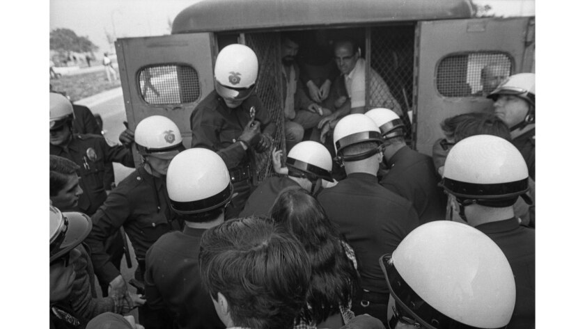 June 23, 1967: Police place arrested protesters into a patrol wagon at Century Plaza during a antiwa