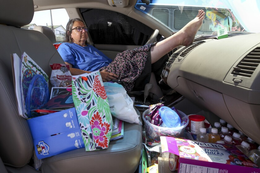 Kim Yarbrough, 61, sits in her 2006 Nissan Altima in a parking lot in Ocean Beach. Yarbrough has been living in her car since last December. Her disability payment and Social Security check were not enough to pay the rent and she has not been able to get a job.