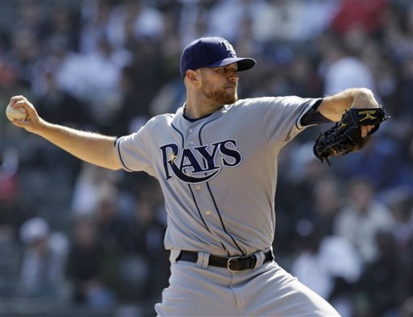 Tampa Bay Rays starting pitcher Wade Davis throws during the first inning of a baseball game against the Chicago White Sox in Chicago, Saturday, April 9, 2011. (AP Photo/Nam Y. Huh)