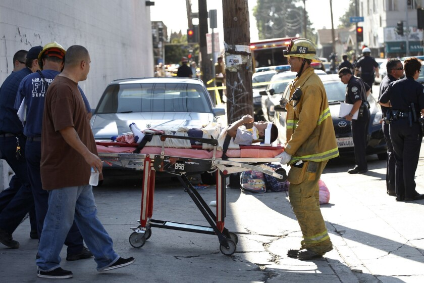 A young boy is transported to an ambulance after a car driven by an elderly driver ran into a group of children and adults near a South Los Angeles school in 2012. The incident was among several that have fanned discussions about older drivers and public safety.