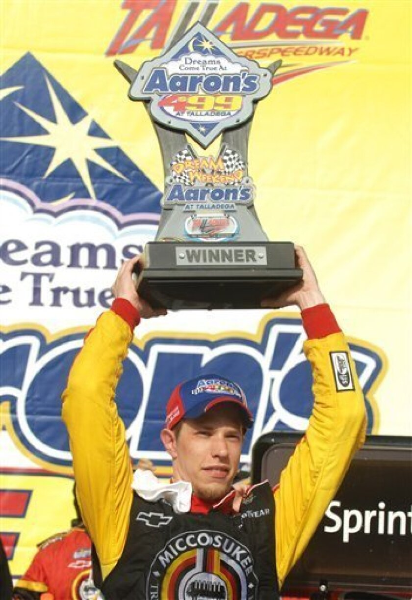 Brad Keselowski celebrates in victory lane after winning the Aaron's 499 NASCAR Sprint Cup auto race at Talladega Superspeedway, Sunday, April 26, 2009, in Talladega, Ala. (AP Photo/Rainier Ehrhardt)