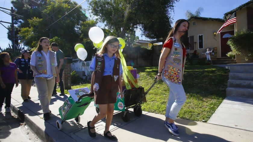 Take photos of girl scouts selling cookies on Sunday, the first day of sales for this year. Ambassa